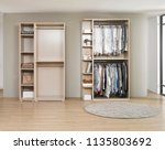 big wardrobe with different... | Shutterstock . vector #1135803692