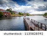 the  wooden pier for boats and... | Shutterstock . vector #1135828592