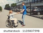 woman in a wheelchair with her... | Shutterstock . vector #1135837598