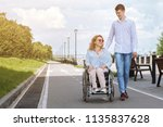 woman in a wheelchair with her... | Shutterstock . vector #1135837628