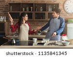couple cooking pastry and... | Shutterstock . vector #1135841345