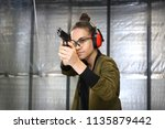 recreational shooting at the... | Shutterstock . vector #1135879442