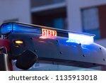 flashing lights of red fire... | Shutterstock . vector #1135913018