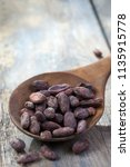 cacao bean in wooden spoon with ... | Shutterstock . vector #1135915778