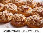 homemade pastry with a topping... | Shutterstock . vector #1135918142