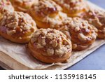 homemade pastry with a topping... | Shutterstock . vector #1135918145
