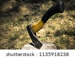 hatchet with yellow and black... | Shutterstock . vector #1135918238