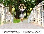 student schoolgirl happy with... | Shutterstock . vector #1135926236