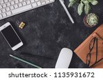 flat lay. working place on dark ...   Shutterstock . vector #1135931672