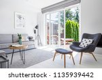 armchair with patterned pillow... | Shutterstock . vector #1135939442