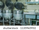 three stainless steel... | Shutterstock . vector #1135965932