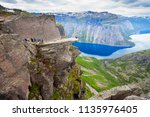 trolltunga or troll tongue is a ... | Shutterstock . vector #1135976405