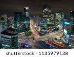 night scene of light trails... | Shutterstock . vector #1135979138