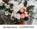 banquet table is decorated with ... | Shutterstock . vector #1135987505