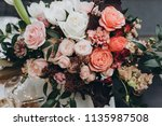 banquet table is decorated with ... | Shutterstock . vector #1135987508