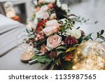 banquet table is decorated with ... | Shutterstock . vector #1135987565
