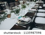 banquet table is decorated with ... | Shutterstock . vector #1135987598