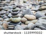 stack of pebble stones or zen... | Shutterstock . vector #1135995032