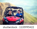 friends driving off road with... | Shutterstock . vector #1135995422
