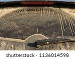 dirty back window in car | Shutterstock . vector #1136014598