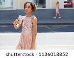 young beautiful girl is... | Shutterstock . vector #1136018852