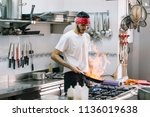 chef cooking preparing food and ... | Shutterstock . vector #1136019638