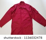 protective worker's red overall ...   Shutterstock . vector #1136032478
