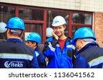 group of  builders in hardhats. ... | Shutterstock . vector #1136041562