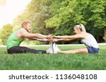 young couple working out in park | Shutterstock . vector #1136048108