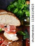 bruschetta with dried jamon ... | Shutterstock . vector #1136114825