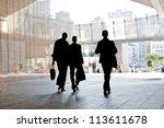 Three Business People Walking...