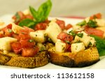 fresh bruschetta with tomatoes... | Shutterstock . vector #113612158