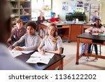 male high school tutor teaching ... | Shutterstock . vector #1136122202