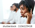 contact center operator... | Shutterstock . vector #1136125418