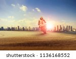 man riding big motorcycle on... | Shutterstock . vector #1136168552