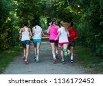 the view from behind of a group ...   Shutterstock . vector #1136172452