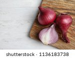 wooden board with ripe red... | Shutterstock . vector #1136183738