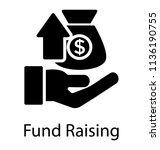 hand havin a money bag where a... | Shutterstock .eps vector #1136190755