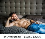 shirtless sexy male model lying ... | Shutterstock . vector #1136212208