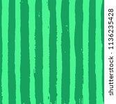 green striped watermelon... | Shutterstock .eps vector #1136235428