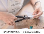 artist cutting sheets of... | Shutterstock . vector #1136278382