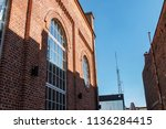 two buildings made by bricks in ...   Shutterstock . vector #1136284415