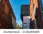 two buildings made by bricks in ...   Shutterstock . vector #1136284685