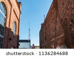 two buildings made by bricks in ...   Shutterstock . vector #1136284688