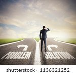 businessman at a crossroads. he ... | Shutterstock . vector #1136321252