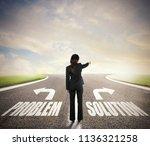 businesswoman at a crossroads....   Shutterstock . vector #1136321258