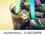 background of cola with ice and ... | Shutterstock . vector #1136328698