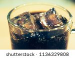 background of cola with ice and ... | Shutterstock . vector #1136329808