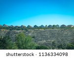 a congested row of hilltop... | Shutterstock . vector #1136334098