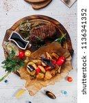 steak pork roasted with... | Shutterstock . vector #1136341352